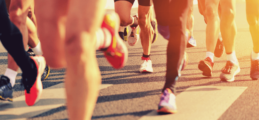 People running a race with healthy legs - Palisades Vein Center