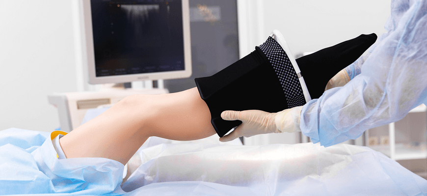 patient receiving compression stockings - Palisades Vein Center