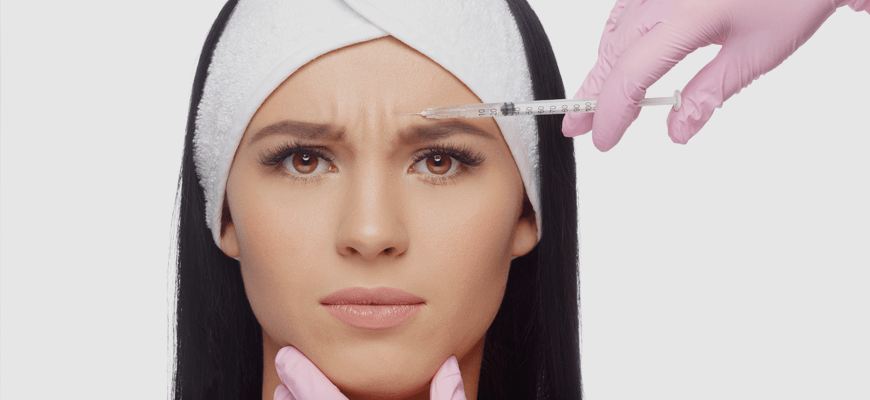Palisades Vein Center- a woman receiving botox in her forehead